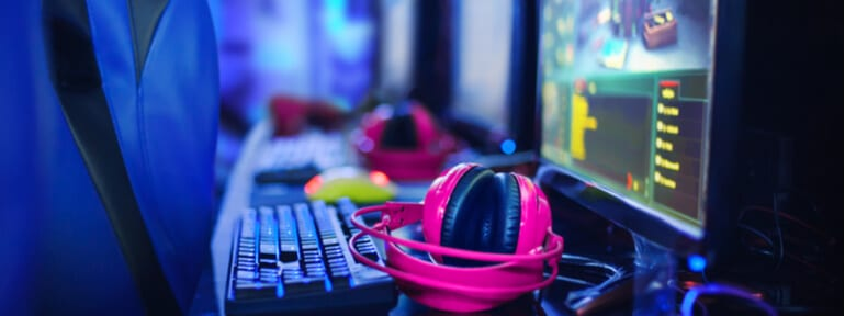 pink headphones on gaming computer
