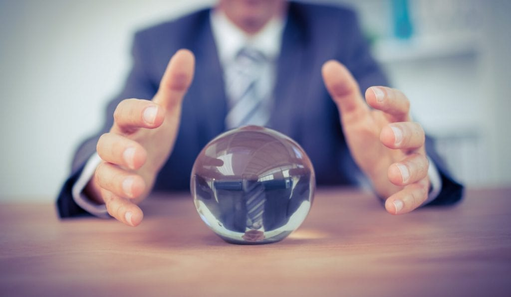 hands around crystal ball